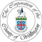 "Circular emblem, surrounded by text that reads ""The Corporation of the County of Wellington""."