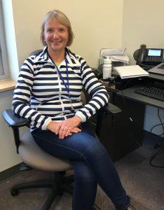 CMHA WW Nurse Lorraine Silvani sits at a desk in an office